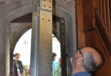 A new beam for the bells to hang from is eased into the bell tower.