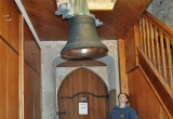 Slowly a new bell is winched up into the bell tower watched by Becky Noyes.