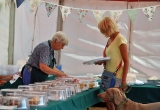 THE WI SERVE ALL COMERS IN THE TEA TENT AT BRIGHSTONE SUMMER SHOW