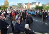 Crowds gather around Brighstone War Memorial