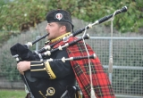 PIPER JOHN BRODIE STARTS THE DRUMHEAD