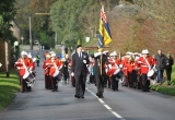 The Remembrance Parade marches up Main Road