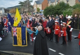 Standards lowered in tribute at Brighstone War Memorial.