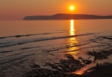 Sunset over Compton Bay by Paul Bradley